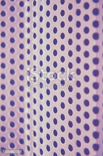1176496357 istock photo Background of metal mesh grid with round holes, close-up 1220982732