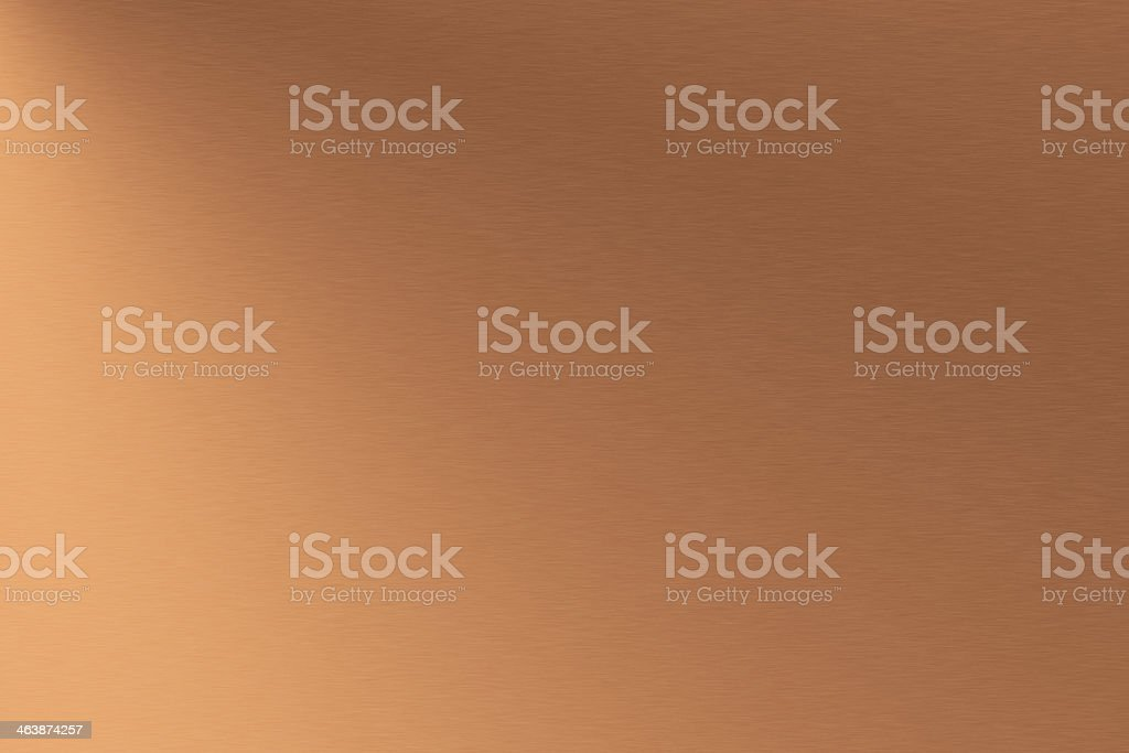 A background of metallic copper brushed metal stock photo