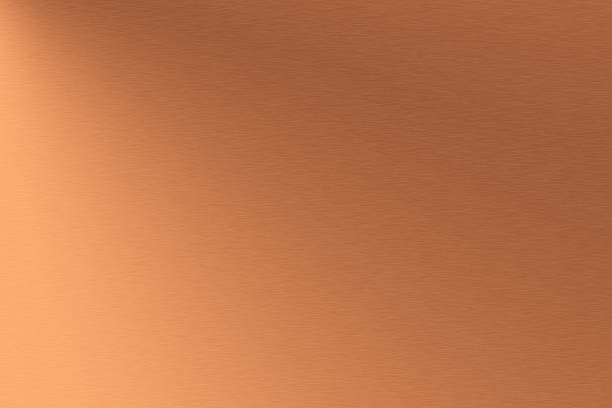 a background of metallic copper brushed metal - copper stock photos and pictures