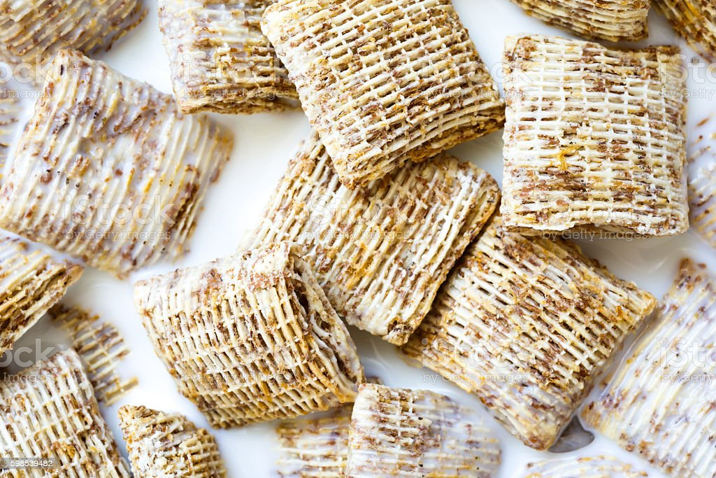 Background of mini shredded wholegrain biscuits with milk from a photo libre de droits