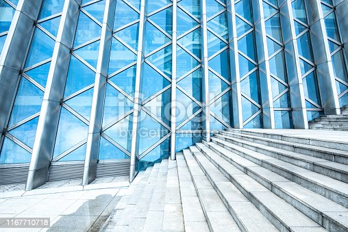 background of modern building, wall reflection with blue sky