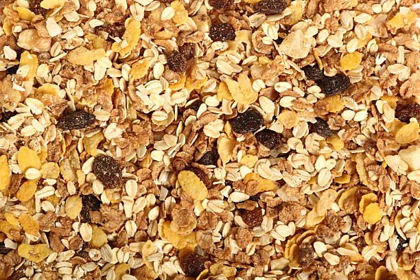 background of muesli with dried fruits. directly above. - granola imagens e fotografias de stock
