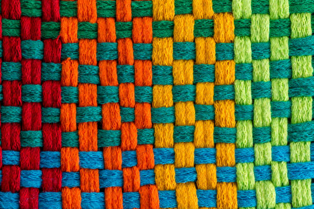 Background of multicolored threads of fabric stock photo
