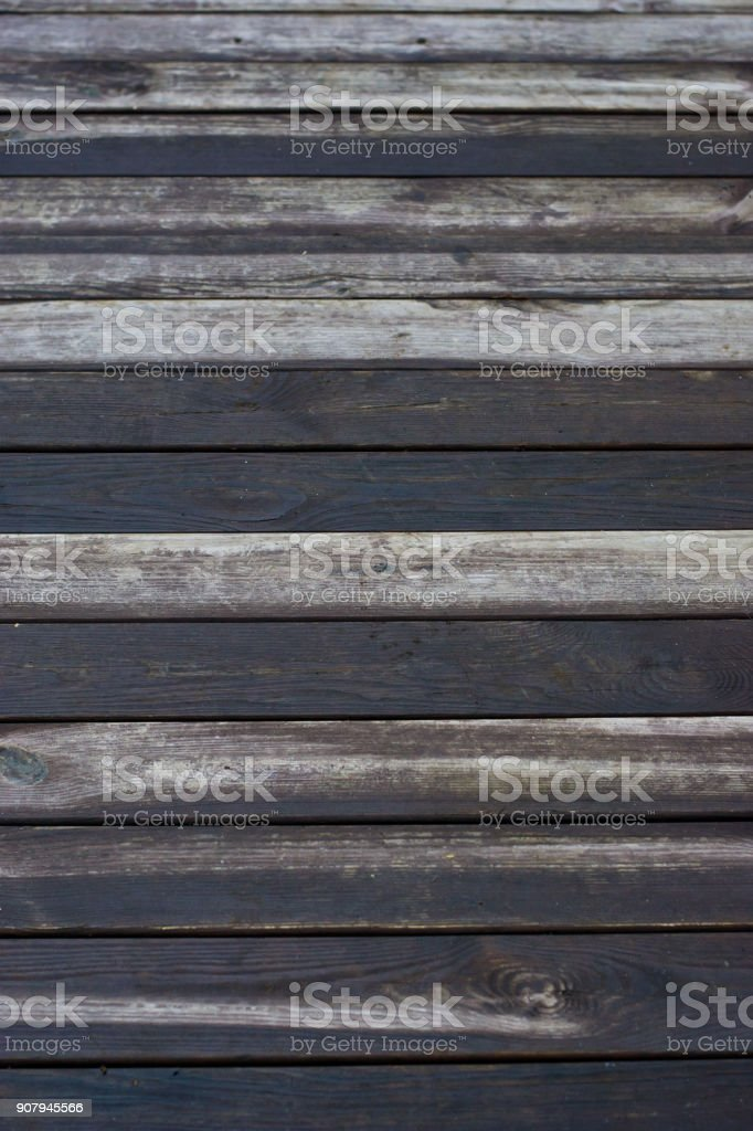 Background of natural knotted wooden walkpath. Wooden texture. stock photo