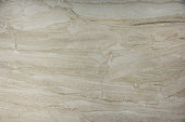 Background of natural stone marble beige color with a beautiful pattern, called Bressia Sarda