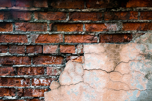 Background of old brick and cracked plaster