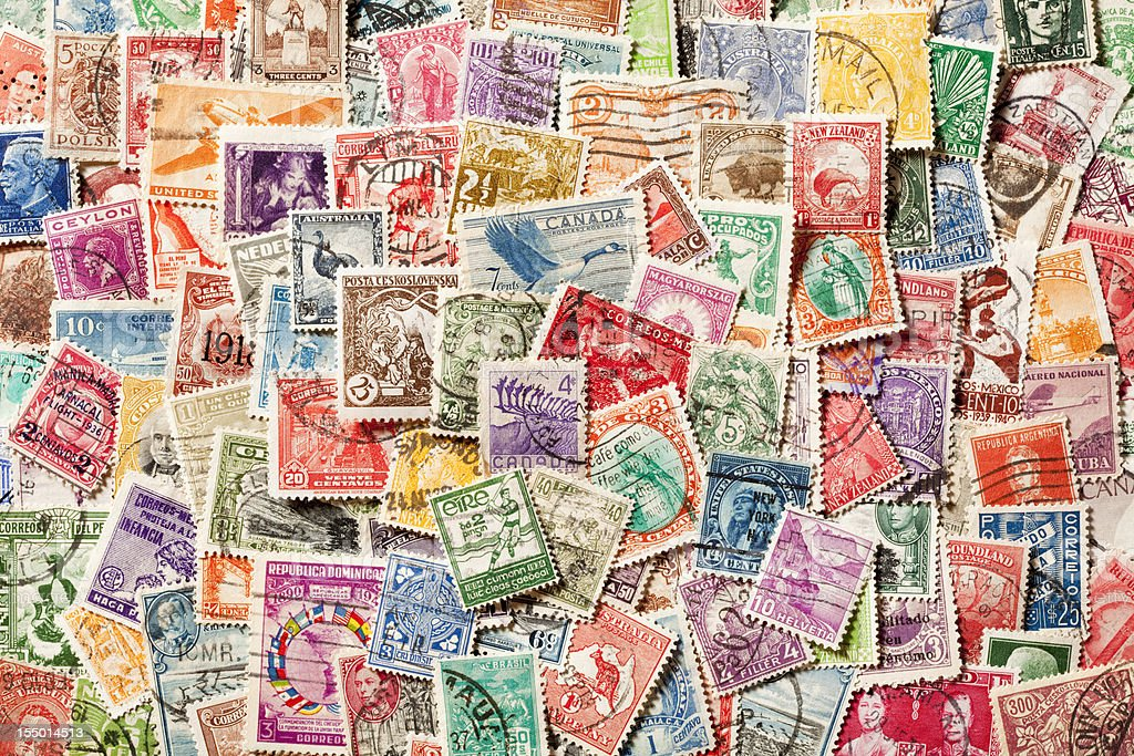 Background of old, canceled Postage Stamps. XXXL royalty-free stock photo