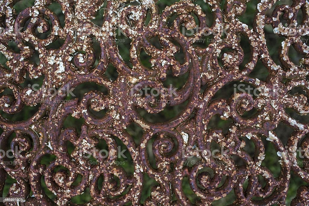 Background of old rusty wrought iron park bench royalty-free stock photo
