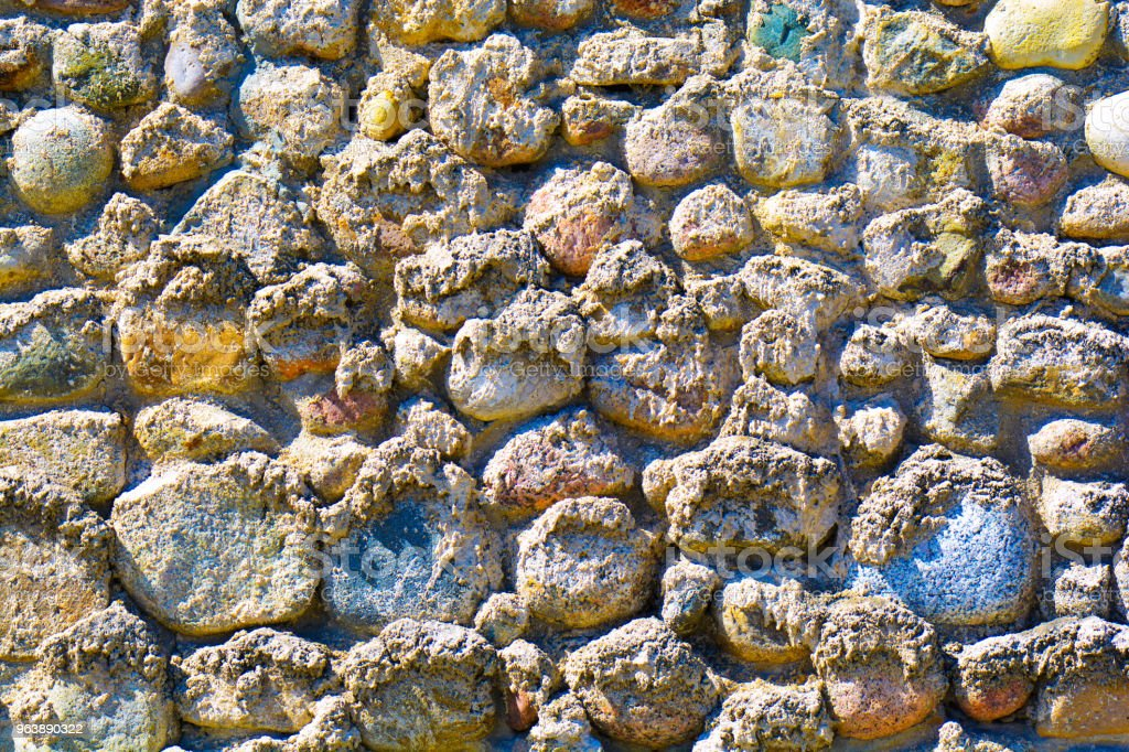 Background of old stone wall texture photo. Colorful old stone wall - Royalty-free Antique Stock Photo