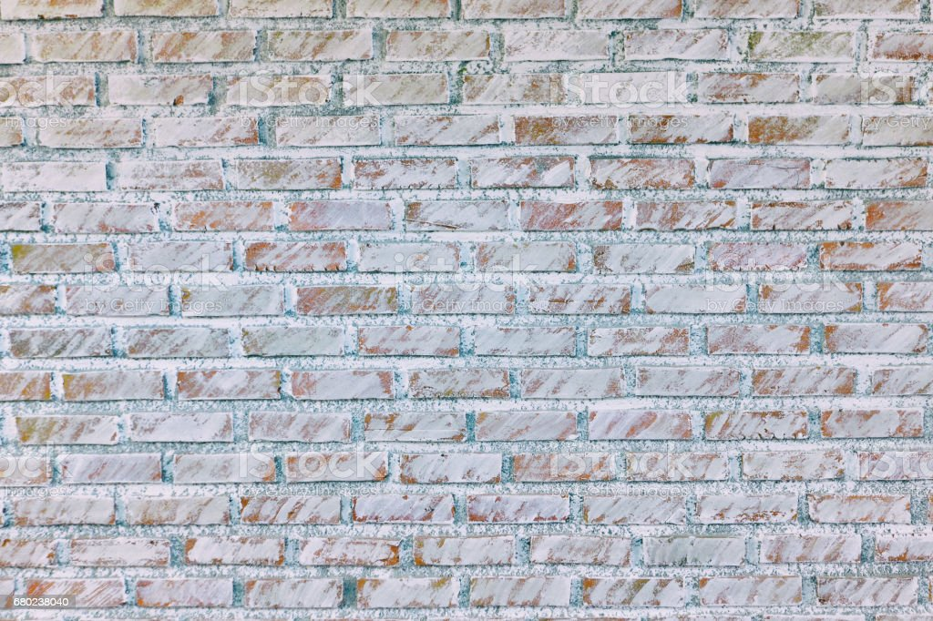 Background of old vintage dirty brick wall with peeling plaster, texture stock photo