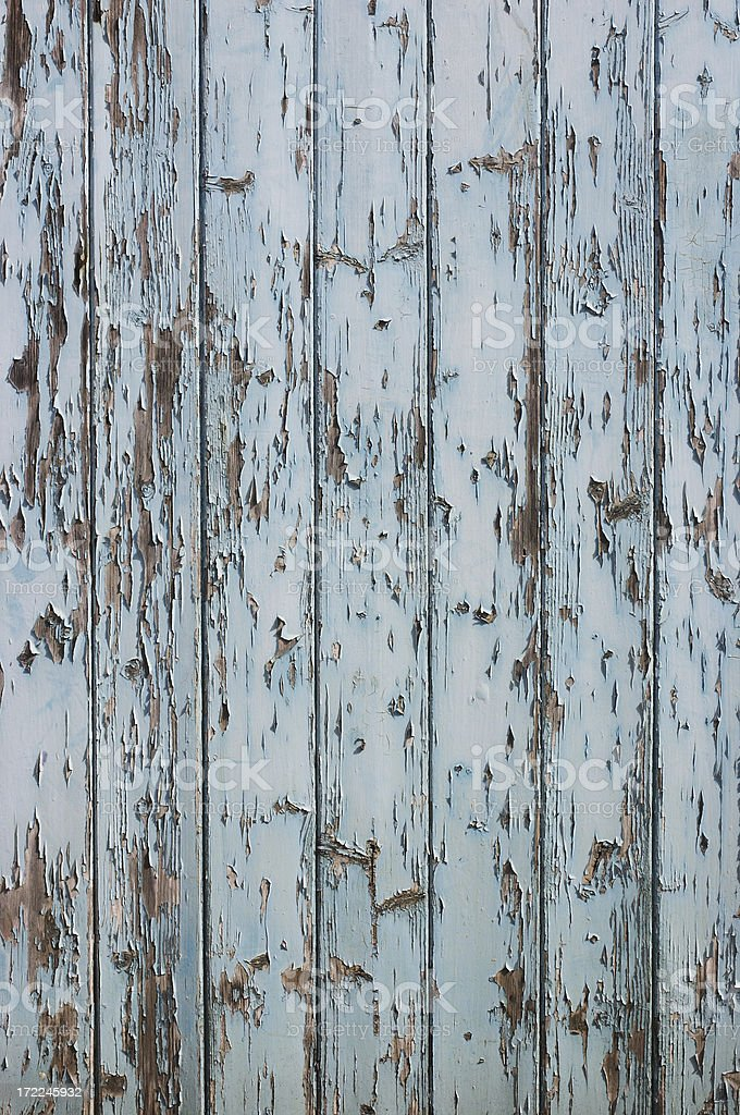 Pale blue peeling paint stock photo