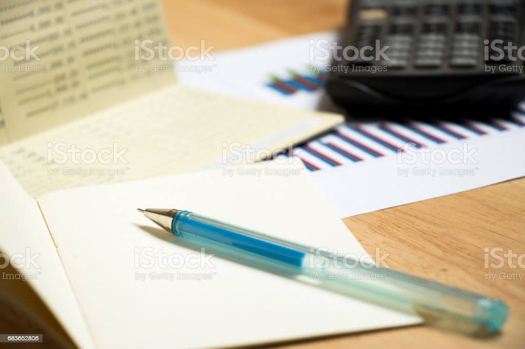 Background of passbook, note book with pen, calculator and financial graph stock photo