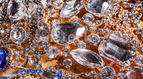Background of precious golden and silver jewelry