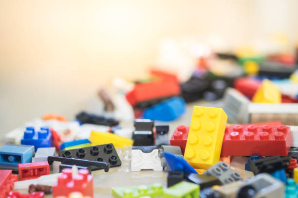 Background of random coloured plastic construction blocks or brick toy. Concept of education, development and growth. stock photo