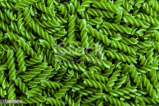 raw macaroni green background to use as a poster in markets or magazines