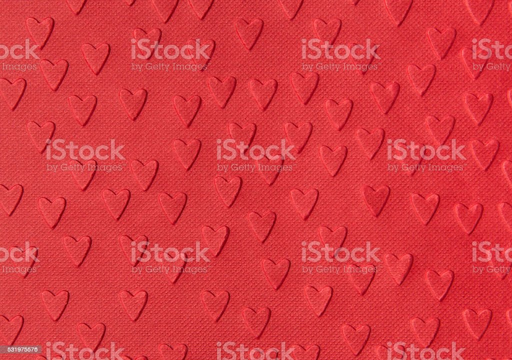 Background of red paper with embossed hearts Background of red paper with embossed hearts Abstract Stock Photo