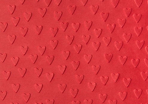 Background Of Red Paper With Embossed Hearts Stock Photo - Download Image Now