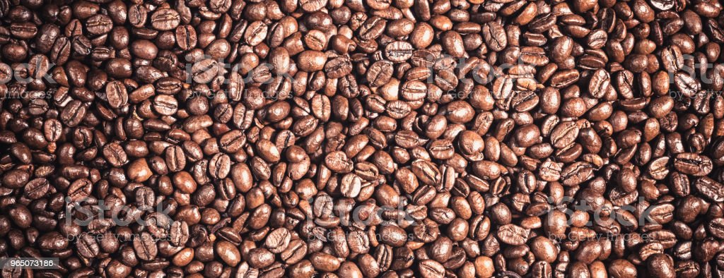 Background of  roasted coffee grains macro close-up royalty-free stock photo