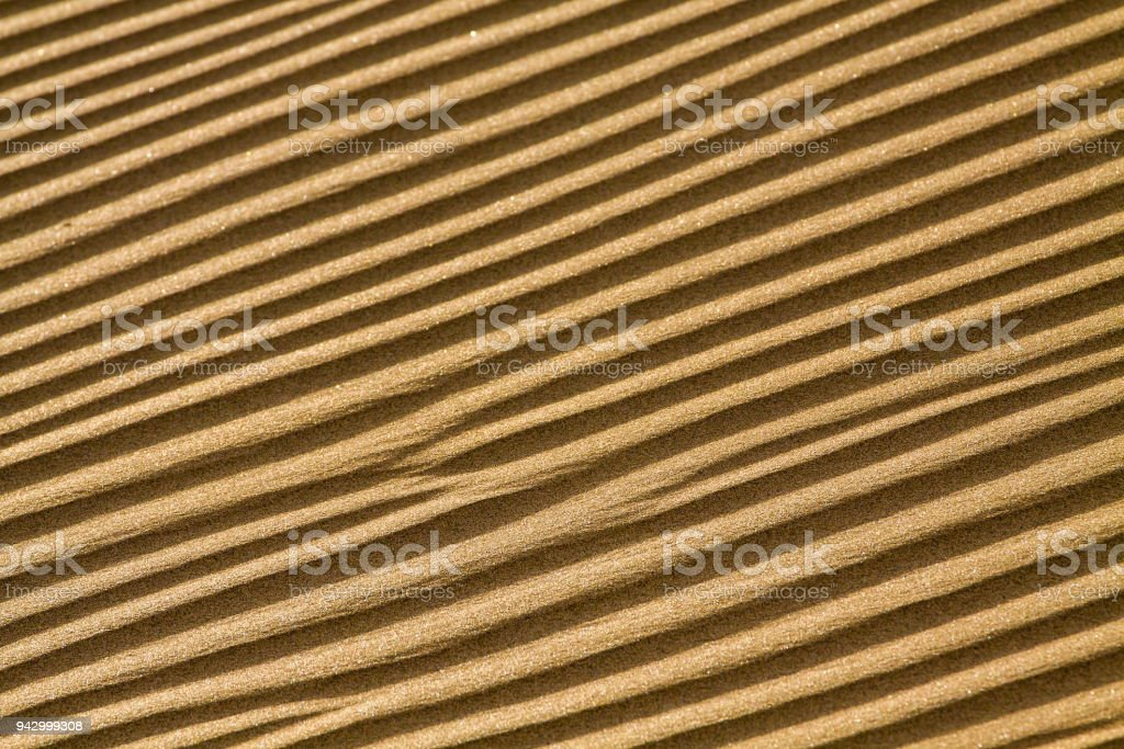 Background of sand ripples with cleary shapes. stock photo