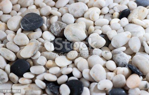 Background of sea pebbles close-up. Sea pebble texture.