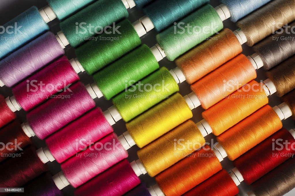 A background of several different colored types of thread  stock photo