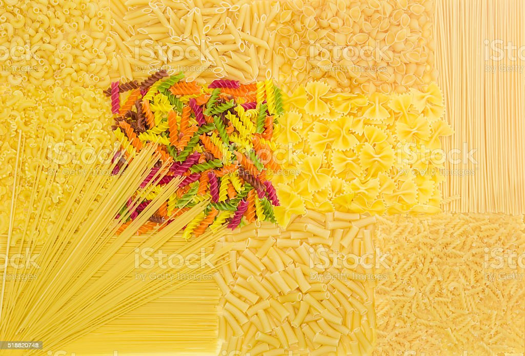 Background of several uncooked pasta different varieties stock photo