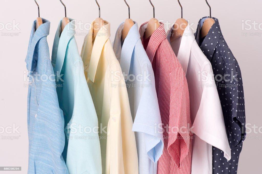 background of shirts hanging on hanger royalty-free stock photo