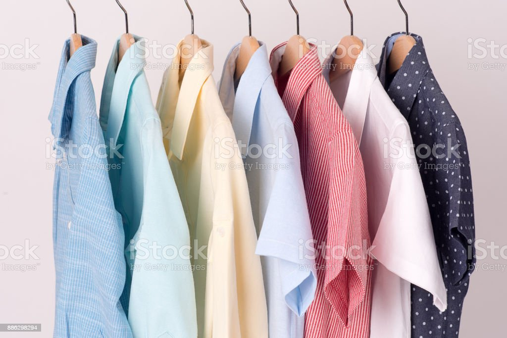 background of shirts hanging on hanger stock photo