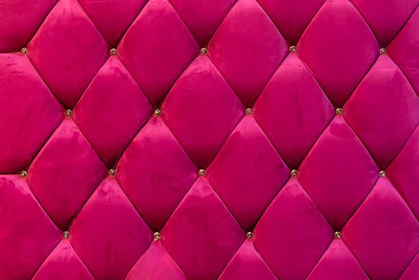 background of shocking pink velvet sofa with crystal botton stock photo