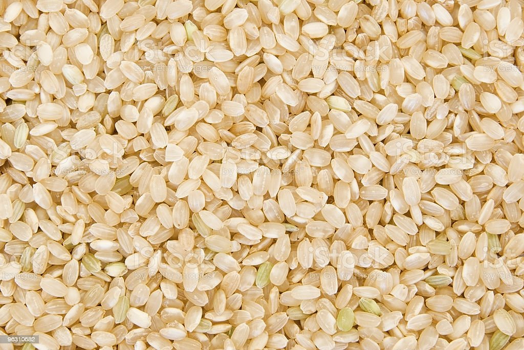 Background of short grain brown rice stock photo