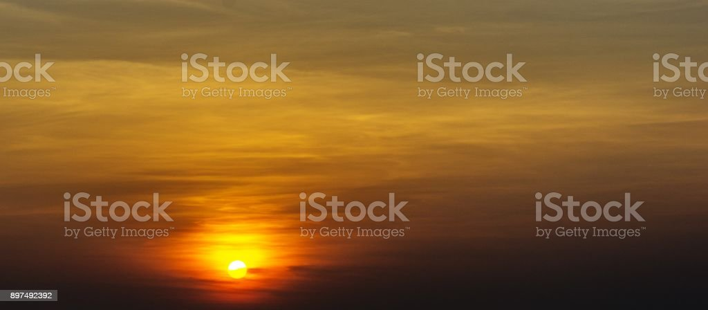 Background of sky with cloud and sun at  twilight time stock photo