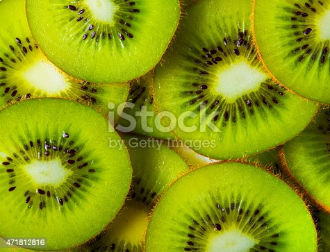 background made with a heap of sliced kiwis