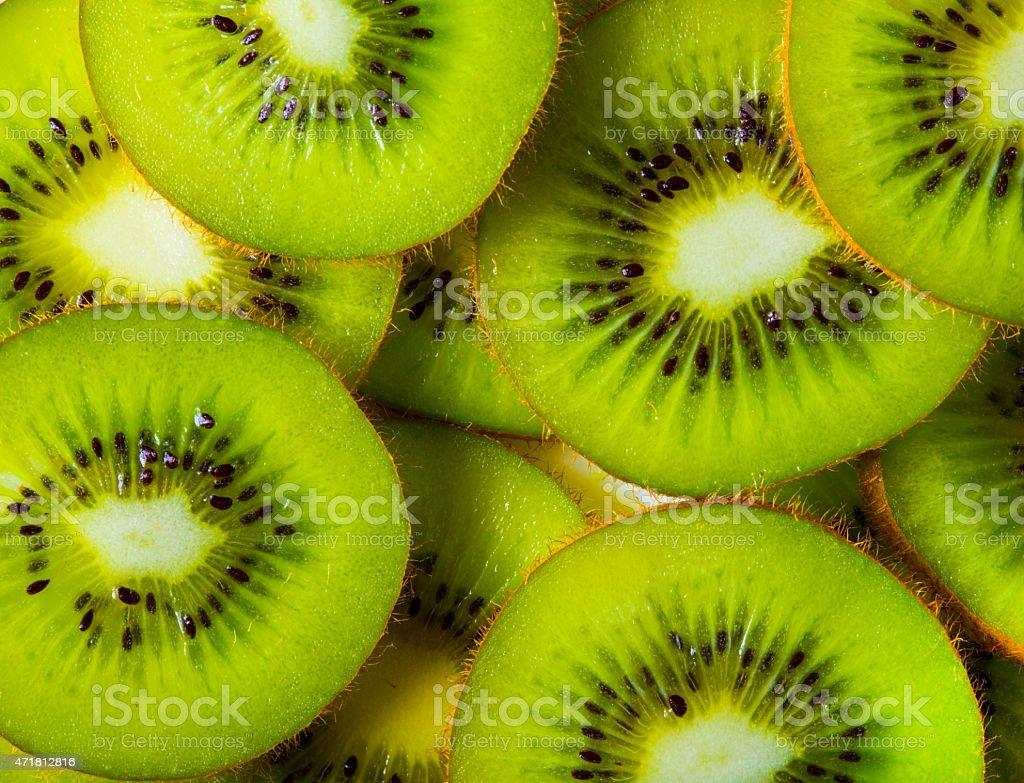 Background of sliced kiwi layered stock photo