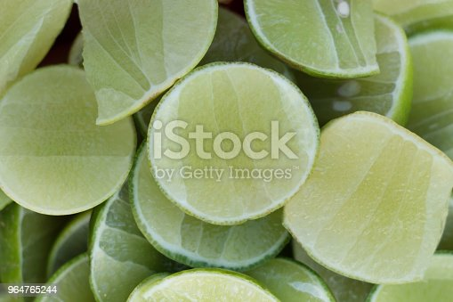 Background Of Sliced Lime Stock Photo & More Pictures of Bright