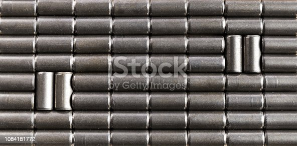 511814244istockphoto Background of small cylindrical pieces of iron 1084181772