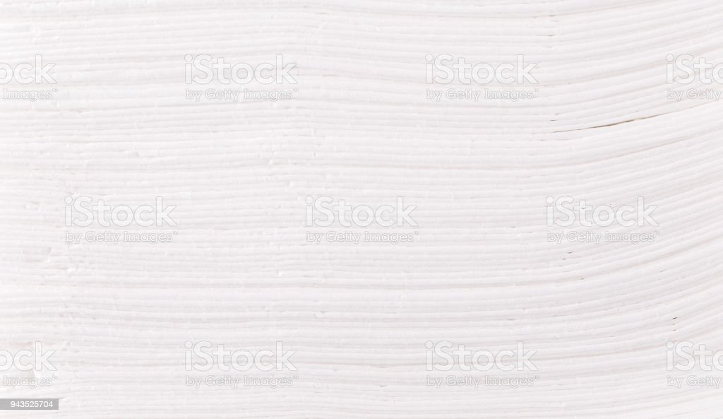 Background of Stack of folded disposable paper tissues. stock photo