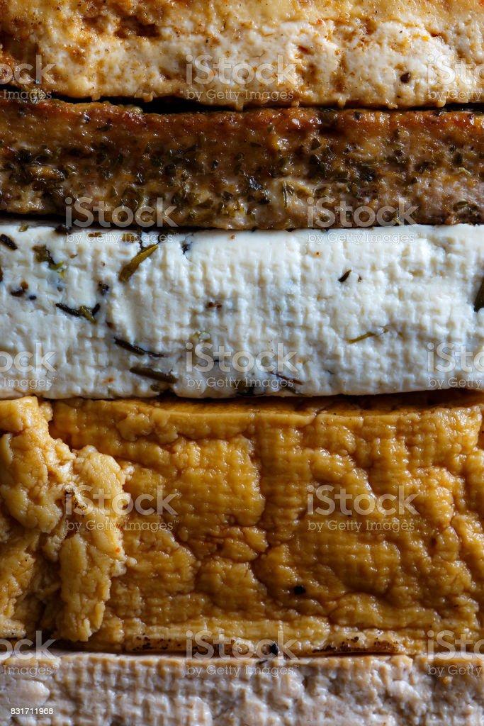 Background of stack of mixed tofu blocks. stock photo