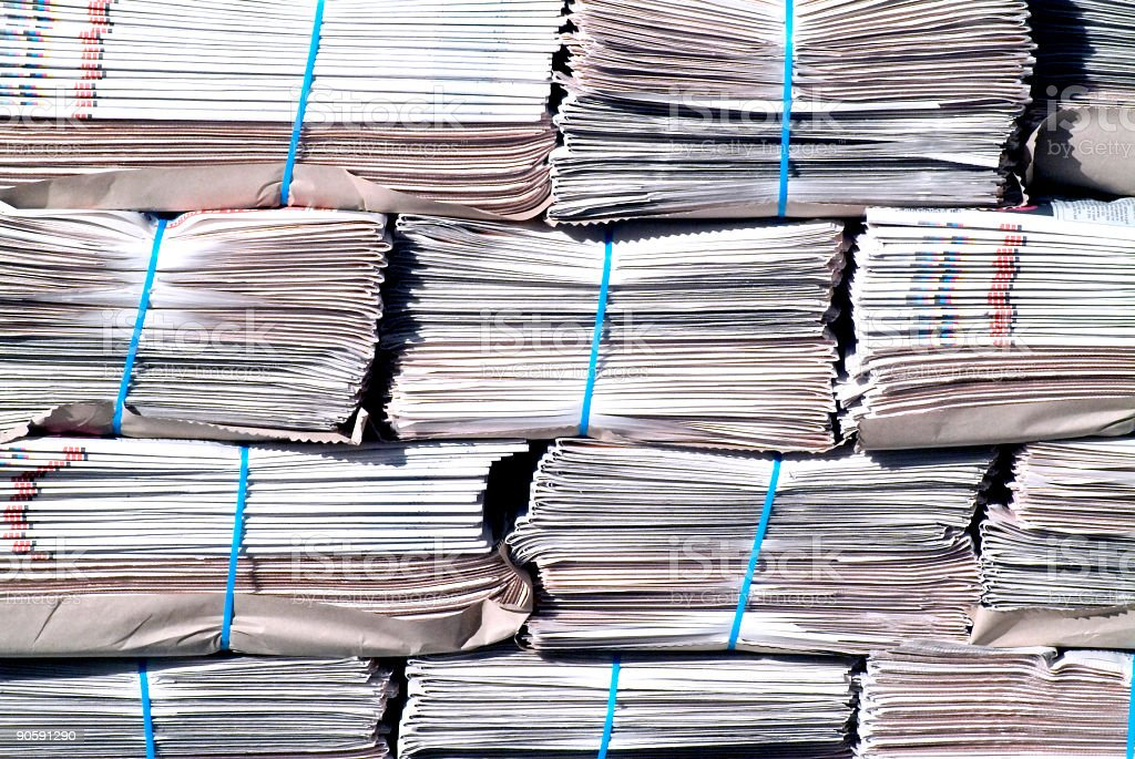 Background of stacks of newspapers Bundles of newspapers in a stack. Broadsheet Stock Photo