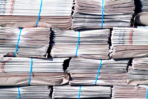 Background Of Stacks Of Newspapers Stock Photo - Download Image Now