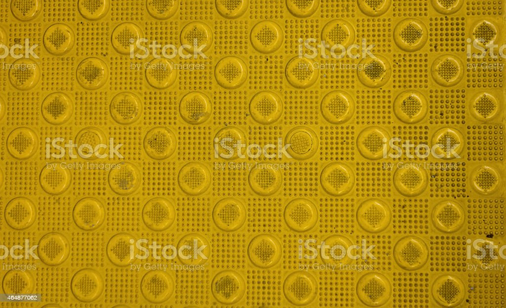 Background of Stamped Metal Yellow Circles stock photo