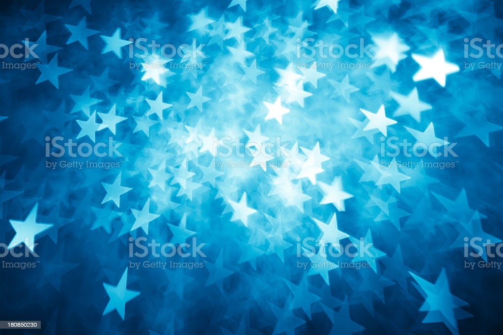 Background of star shaped lights in shades of blue stock photo