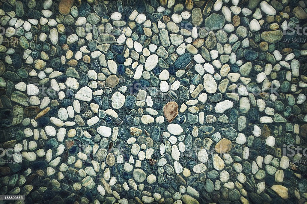 Background of stones in a concrete wall effect stock photo