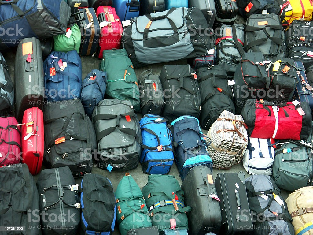 Background of suitcases, travel bags in different shape and color royalty-free stock photo