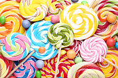 Background of sweet candies and lollipops