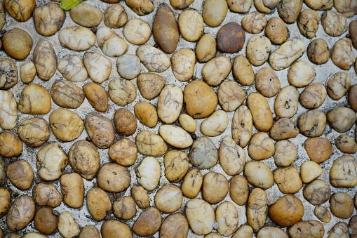 River rock wall texture in sidewalk