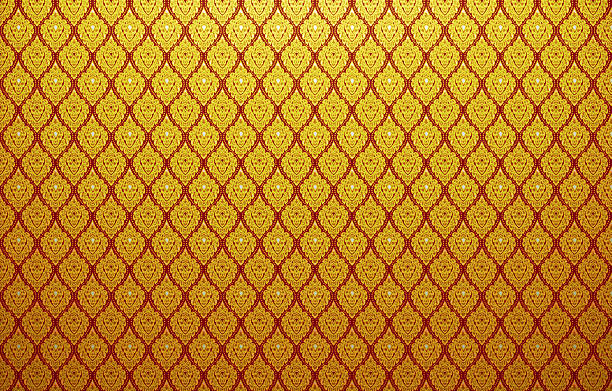 background of thai style fabric pattern with golden - thai culture stock photos and pictures