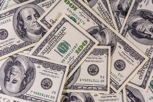 istock Background of the many american one hundred dollar banknotes 1160534857