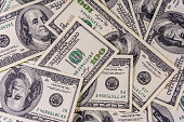 Background of many american one hundred dollar banknotes