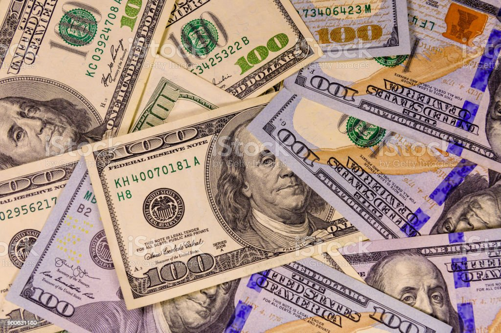 Background of the many one hundred dollar bills stock photo