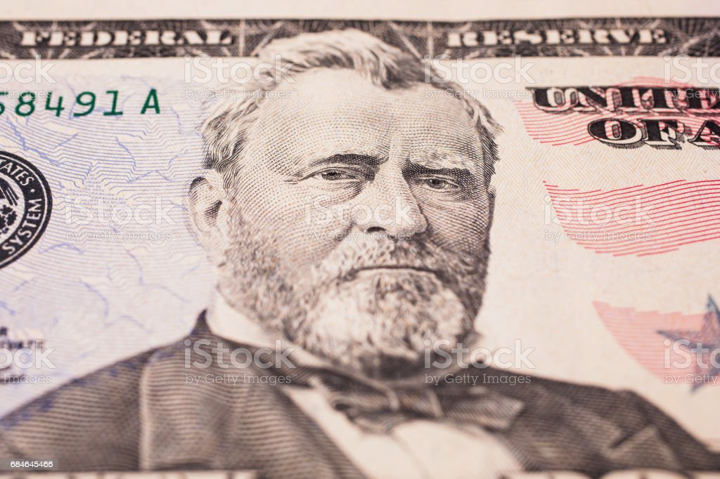 background of the money, fifty dollar bills front side. background of dollars, close up, Portrait of U.S. statesman, inventor, and diplomat Ulysses S. Grant as he looks on fifty dollar bill obverse , face bill of fifty dollars stock photo